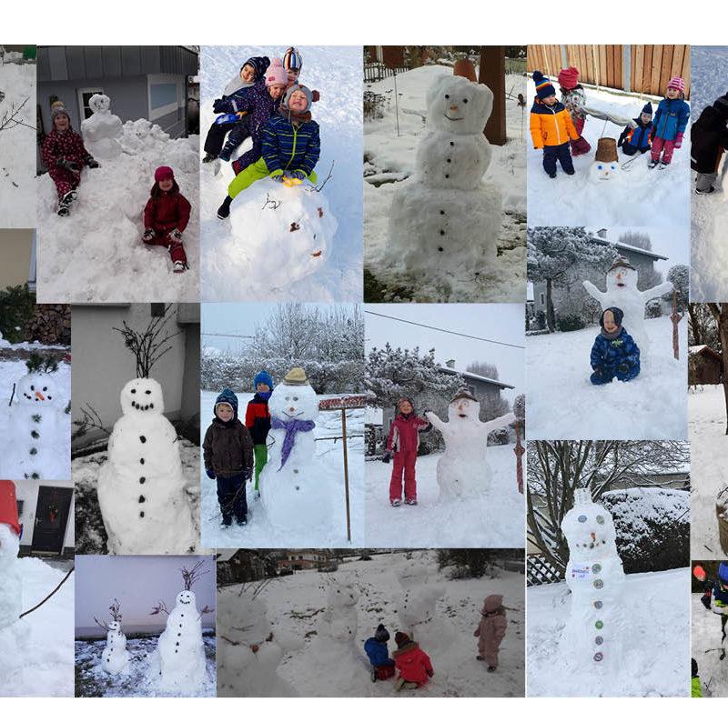 Tagesmütter bauen Schneemänner mit ihren Tageskindern.